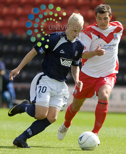 Leigh Griffiths of Dundee takes on Kevin McDonald during the  SFL division one Airdrie United v Dundee FC at Excelsior Stadium, Airdrie..Picture: Universal News And Sport (Scotland) 29 August 2009..