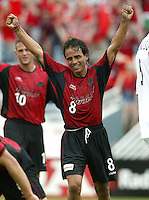 26 June 2004:   Dallas Burn Oscar Pareja celebrates after Jason Kreis scored a goal against DC United at Cotton Bowl in Dallas, Texas.   DC United and Dallas Burn are tied 1-1 after the game.   Credit: Michael Pimentel / ISI