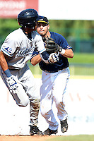 Lake County Captains second baseman Argenis Martinez #13 chases down Dixon Machado #13 in a run down during the second game of a double header against the West Michigan Whitecaps at Classic Park on May 30, 2011 in Eastlake, Ohio.  Lake County defeated West Michigan 4-3.  Photo By Mike Janes/Four Seam Images