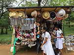 School girls browsing souvenir stall, Polonnaruwa, North Central Province, Sri Lanka, Asia