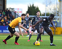 Lincoln City's John Akinde shields the ball from  Cambridge United's Greg Taylor<br /> <br /> Photographer Andrew Vaughan/CameraSport<br /> <br /> The EFL Sky Bet League Two - Cambridge United v Lincoln City - Saturday 29th December 2018  - Abbey Stadium - Cambridge<br /> <br /> World Copyright © 2018 CameraSport. All rights reserved. 43 Linden Ave. Countesthorpe. Leicester. England. LE8 5PG - Tel: +44 (0) 116 277 4147 - admin@camerasport.com - www.camerasport.com