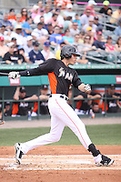 Miami Marlins left fielder Christian Yelich (76) at bat against the Houston Astros during a spring training game at the Roger Dean Complex in Jupiter, Florida on March 12, 2013. Houston defeated Miami 9-4. (Stacy Jo Grant/Four Seam Images)........