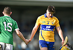 A disappointed Bradley Higgins of Clare  shakes the hand of opposition player Oisin O Reilly following their Munster U-21 hurling quarter final against Limerick at Cusack park. Photograph by John Kelly.