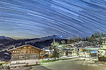 """Pictured: Hundreds of thousands of stars stretch across the winter night sky in this breathtaking long exposure image. Photographer Rainer Awiszus-Emser took this composite which looks over the idyllic village Ruschein in Switzerland. <br /> <br /> The 62 year old took the image late at night to capture the stunning stair trails that dominate the night sky. He said """"In total this picture is made up of over 110 single shots, each with an exposure time of 50 seconds which are then stitched together to create this one frame""""<br /> <br /> """"I took the images between 00:41 and 02:15 in the night to minimise noise and aircraft travelling across the sky, which would ruin the startrail.""""<br /> <br /> The photographer from Kreuzlingen, Switzerland said """"On the night of the image the temperature was about -5 to -6 degrees Celsius, with 10-20 centimetres of snow. The image overlooks the village of Ruschein, with the church Kirche Ruschein in the centre."""" <br /> <br /> Please byline: Rainer Awiszus-Emser/Solent News<br /> <br /> © Rainer Awiszus-Emser/Solent News & Photo Agency<br /> UK +44 (0) 2380 458800"""