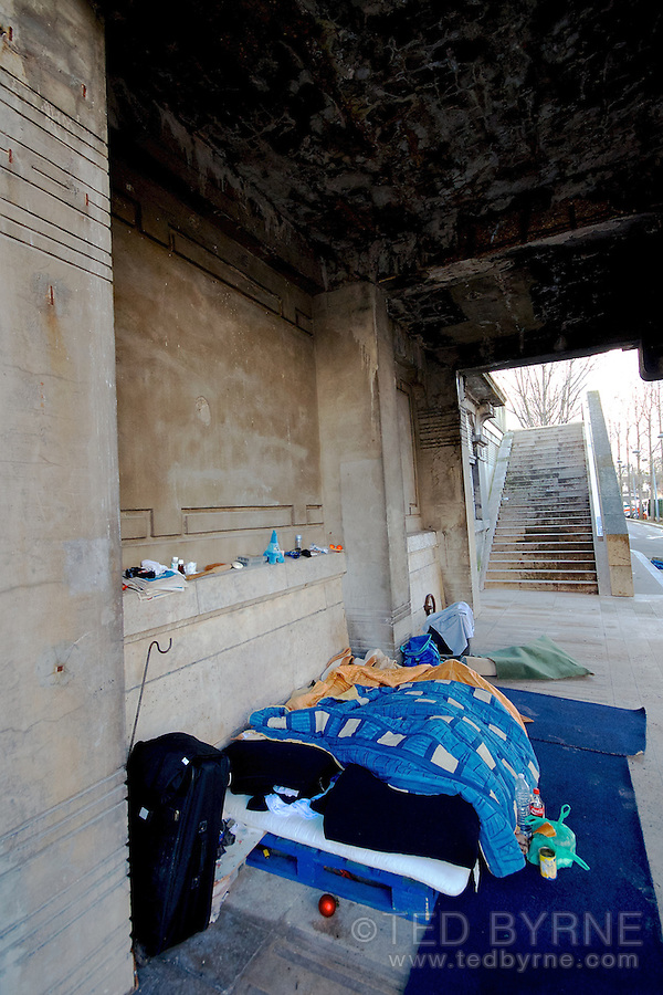 Homeless person's bedroom under a bridge in Paris