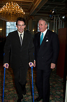 Montreal, April 4rd 2001<br /> Quebecor President and CEO and Vice-Chairman of the Board of Quebecor World ; Pierre-Karl Peladeau (left) on crutches after a skiing accident in Europe speak with Sun Media Corp Chairman of the Board ;  The Right Honorable Brian Mulroney after the<br /> Quebecor World annual meeting, April 4th 2001, in Montreal, CANADA<br /> <br /> Since the `` Merger of equals `` between Quebecor Printing and World Color, the company operating margin reached a record high of 11.1 % for the year ; revenues increased by 32 % to 6.5 billion US $ ; operating income increased by 53 % to 724.8 Million US $  and net income increased by 43 % to 293.4 Million US $, or 1,93 US $ per share.<br /> <br /> Quebecor World is now the largest and strongest performing entity in the printing field<br /> Photo by Pierre Roussel  / I Photo<br /> NOTE :  D-1 photo uncorrected