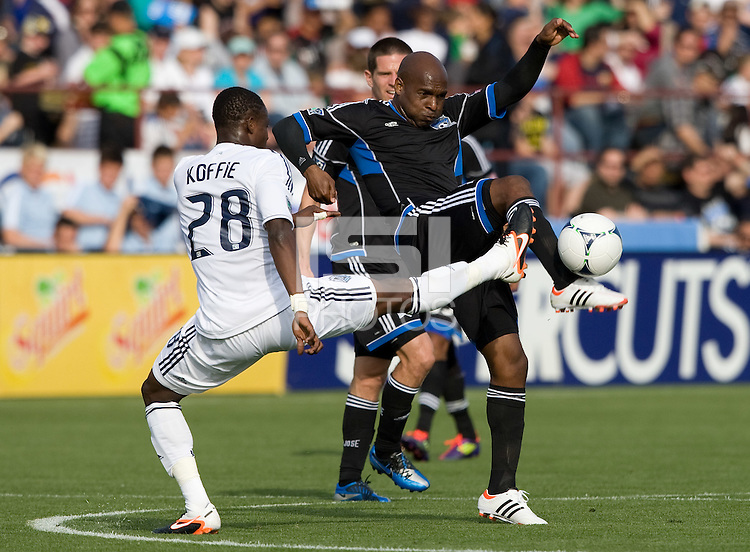 Tressor Moreno of Earthquakes kicks the ball away from Gershon Koffie of Whitecaps during the game at Buck Shaw Stadium in Santa Clara, California on April 7th, 2012.  San Jose Earthquakes defeated Vancouver Whitecaps, 3-1.