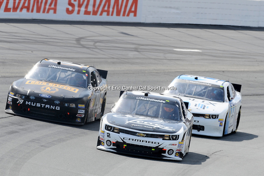 "July 13, 2013 - Loudon, New Hampshire U.S. - Nationwide Series driver Brian Scott (2) gets in front of  Jeffrey Earnhardt (79) and Stranton Barrett (23) racing in the NASCAR Nationwide Series CNBC Prime's ""The Profit"" 200 race being held at the New Hampshire Motor Speedway in Loudon, New Hampshire.   Eric Canha/CSM"