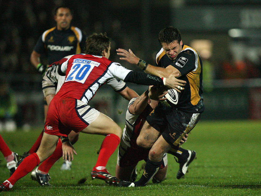 Photo: Rich Eaton..Worcester Warriors v Gloucester Rugby. Guinness Premiership. 13/10/2006. Thomas Lombard of Worcester is tackled by Rory Lawson of Gloucester.