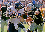 Oakland Raiders vs. San Diego Chargers at Oakland Alameda County Coliseum Sunday, October 11, 1998.  Raiders beat Chargers  7-6.  Oakland Raiders linebacker Greg Biekert (54) pressures San Diego Chargers running back Natrone Means (20).