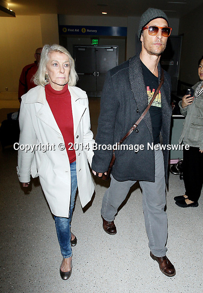 Pictured: Matthew McConaughey<br /> Mandatory Credit &copy; CALA/Broadimage<br /> Matthew McConaughey and mother arriving at the Los Angeles International Airport<br /> <br /> 3/25/14, Los Angeles, California, United States of America<br /> <br /> Broadimage Newswire<br /> Los Angeles 1+  (310) 301-1027<br /> New York      1+  (646) 827-9134<br /> sales@broadimage.com<br /> http://www.broadimage.com