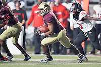 Texas State running back Robert Lowe (28) rushes with the ball during first half of an NCAA Football game, Thursday, November 20, 2014 in San Marcos, Tex. Texas State leads Arkansas State 28-14 at the halftime. (Mo Khursheed/TFV Media via AP Images)