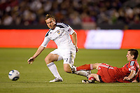 Toronto FC midfielder Sam Cronin (2) attempts a tackle of LA Galaxy midfielder Christopher Birchall (11). The LA Galaxy and Toronto FC played to a 0-0 draw at Home Depot Center stadium in Carson, California on Saturday May 15, 2010.  .