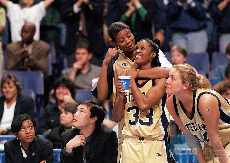 30 MAR 2001:  Forward Amanda Barksdale (31) of Notre Dame celebrates with guard Niele Ivey (33) after defeating the University of Connecticut during the Division 1 Women's Basketball Semifinals held at the Savvis Center in St. Louis, MO.  Notre Dame defeated UCONN 90-75 to advance to the national championship game.  Jamie Schwaberow/NCAA Photos