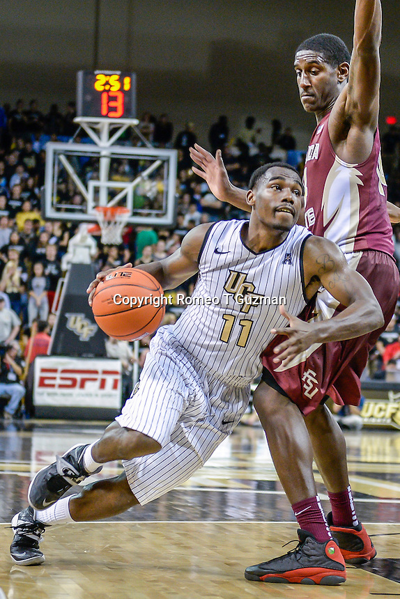 November 13, 2013 - Orlando, FL, U.S: FSU forward Robert Gilchrist (14) defends a drive to the basket by UCF guard Calvin Newell (11) during 2nd half mens NCAA basketball game action between the Florida State Seminoles and the UCF Knights. FSU defeated UCF 80-68 at the CFE Arena in Orlando, Fl.