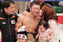 (L to R) Hideyuki Ohashi, Akira Yaegashi (JPN), October 24, 2011 - Boxing : Akira Yaegashi of Japan celebrates after wining with his wife during the WBA Minimum weight title bout at Korakuen, Tokyo, Japan. Akira Yaegashi won by TKO after the fight was stopped in the tenth round. (Photo by Yusuke Nakanishi/AFLO SPORT) [1090].