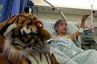 Adham Takatka, 6, a Palestinian boy from the village of Marak Mu' Ala in the Bethlehem district, West Bank is seen in Hadassah Hospital . Adham had a transplant of bone marrow received from his young brother Mohammed in the Hadassah Hospital.  Adham has blood tests twice a week in Hadasssah. Photo by Quique Kierszenbaum.
