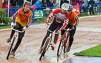 31 AUG 2015 - IPSWICH, GBR - Chris Timms (centre) of Birmingham Monarchs gets in front of Chris Jukes (right) of Wednesfield at the start of a heat at the British Cycle Speedway Championships at Whitton Sports and Community Centre in Ipswich, Suffolk, Great Britain (PHOTO COPYRIGHT © 2015 NIGEL FARROW, ALL RIGHTS RESERVED)