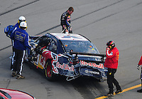 Oct 5, 2008; Talladega, AL, USA; NASCAR Sprint Cup Series driver Brian Vickers walks from his car after blowing a tire and causing a multiple car accident during the Amp Energy 500 at the Talladega Superspeedway. Mandatory Credit: Mark J. Rebilas-