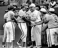 Oakland A's catcher Ray Fosse is conratulated after Home Run, trainer Joe Romo, Wes Stock and manager Alvin Dark..(1974 photo/Ron Riesterer)