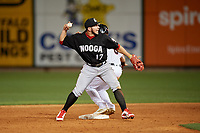 Chattanooga Lookouts second baseman Alberti Chavez (17) throws to first base during a Southern League game against the Birmingham Barons on May 1, 2019 at Regions Field in Birmingham, Alabama.  Chattanooga defeated Birmingham 5-0.  (Mike Janes/Four Seam Images)