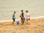 Surf Club Town Beach Park. Boys playing on beach in sand with buckets.