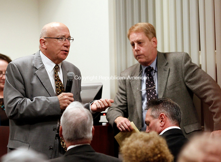 """Waterbury, CT- 23 October 2014-102314CM03- Dr. Stanley Foster, left, of Middlebury talks to an audience during a """"mock"""" Multidisciplinary Breast Cancer Conference at The Leever Cancer Center in Waterbury on Thursday. Listening in is Dr. Scott H. Kurtzman, M.D, with Waterbury Hospital.  Area breast cancer physicians reviewed mock breast cancer cases and talked about the best form of treatment for fictitious patients. The conference demonstrated the work breast cancer specialists experience, including the type of cancer, the stage and the best approach to care.  Christopher Massa Republican-American"""