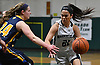Christiana de Borja #21 of Harborfields, right, gets pressured by Lindsey McKenna #24 of Shoreham-Wading River during the Suffolk County varsity girls basketball Class A semifinals at Harborfields High School in Greenlawn, NY on Tuesday, Feb. 21, 2017.