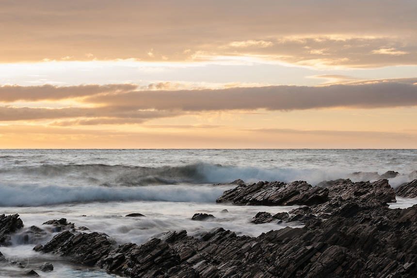 Waves break against sharp rocks at Second Valley.