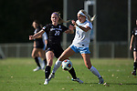 Paige Rombach (20) of the High Point Panthers kicks the ball away from Bridgette Andrzejewski (4) of the North Carolina Tar Heels during first half action at Koka Booth Stadium on November 11, 2017 in Cary, North Carolina.  The Tar Heels defeated the Panthers 3-0.   (Brian Westerholt/Sports On Film)