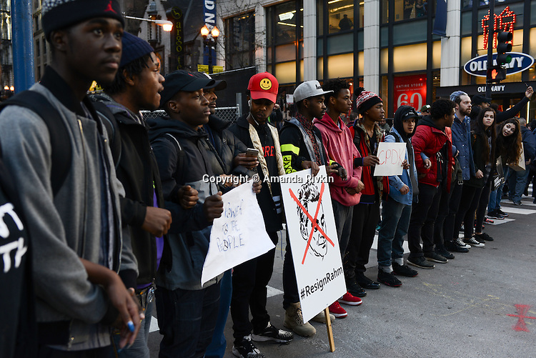 Protesters calling on Chicago Mayor Rahm Emanuel to resign formed a circle and blocked traffic at State and Randolph in the Loop, Chicago, Illinois on December 9, 2015.  Emanuel offered a historic apology for the police killing of Laquan McDonald and police brutality and racial profiling generally -- without using those words -- in front of the City Council in the morning.