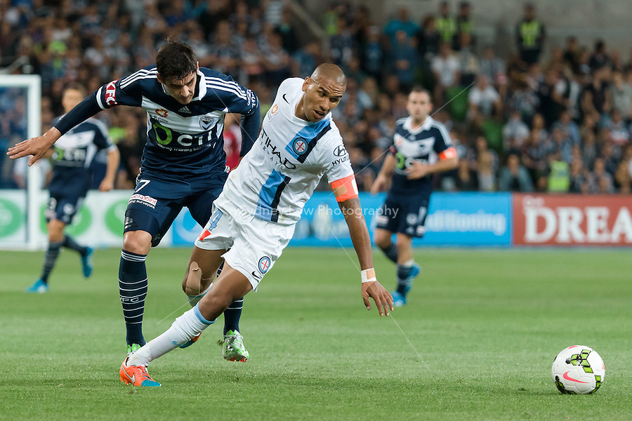 Gui FINKLER of the Victory and Patrick KISNORBO of Melbourne City fight for the ball in round 11 A-League match between Melbourne City and Melbourne Victory at AAMI Park in Melbourne, Australia during the 2014/2015 Australian A-League season. City def Victory 1-0