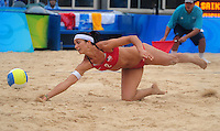 Aug. 10, 2008; Beijing, CHINA; Misty May-Treanor (USA) dives for the ball against Japan during the womens beach volleyball at the Chaoyang Park Beach Volleyball Ground in the 2008 Beijing Olympic Games. The United States won the match. Mandatory Credit: Mark J. Rebilas-