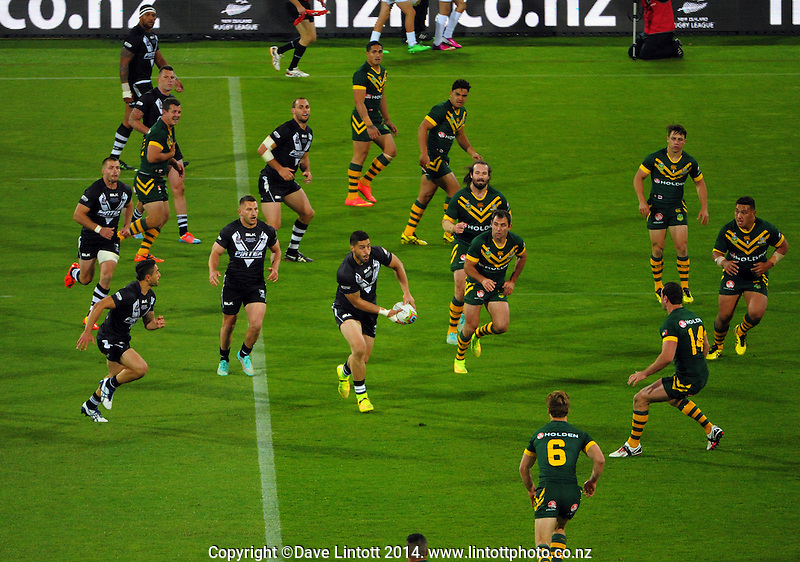 Jesse Bromwich looks to feed Shaun Johnson during the Four Nations rugby league final between the NZ Kiwis and Australia Kangaroos at Westpac Stadium, Wellington on Saturday, 15 November 2014. Photo: Dave Lintott / lintottphoto.co.nz