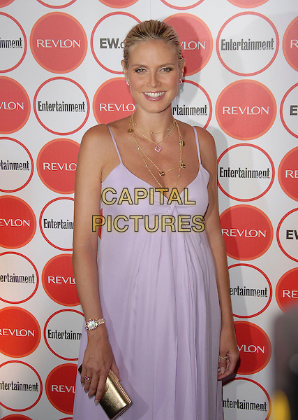 HEIDI KLUM.attends The Entertainment Weekly Pre-Emmy Party held at Republic in West Hollywood, California, USA,.August 26, 2006..half length pregnant long white lilac dress pink flower in hair clip gold necklace clutch bag jewellery watch.Ref: DVS.www.capitalpictures.com.sales@capitalpictures.com.©Debbie VanStory/Capital Pictures