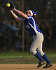 Long Beach shortstop No. 12 Kelsey Larson catches a pop up for an out in the top of the seventh inning of a Nassau County varsity softball game against East Meadow at Long Beach High School on Monday, May 4, 2015. Long Beach won by a score of 2-0.<br /> <br /> James Escher
