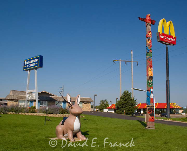 Jackalope Totem Pole and McDonalds sign outside the Thunderbird Lodge motel in Mitchell South Dakota