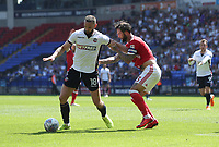 Bolton Wanderers' Aaron Wilbraham battles with Nottingham Forest's Danny Fox whilst having an attempt at goal<br /> <br /> Photographer Rachel Holborn/CameraSport<br /> <br /> The EFL Sky Bet Championship - Bolton Wanderers v Nottingham Forest - Sunday 6th May 2018 - Macron Stadium - Bolton<br /> <br /> World Copyright &copy; 2018 CameraSport. All rights reserved. 43 Linden Ave. Countesthorpe. Leicester. England. LE8 5PG - Tel: +44 (0) 116 277 4147 - admin@camerasport.com - www.camerasport.com