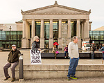 """February 11, 2017. Raleigh, North Carolina.<br /> <br /> Robin Bullock, center, of Black Mountain, NC came to the HKONJ rally to show his dislike for Donald Trump. He said he was """"proud to be part of this resistance"""".<br /> <br /> Thousands gathered in downtown Raleigh for the annual HKONJ People's Assembly, a civil rights march tied to the Moral Monday movement. Supporters from around the state gathered to march and speak out against nationwide attacks on civil rights and the Trump administration.<br /> <br /> Jeremy M. Lange for The New York Times"""