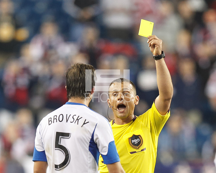 Yellow Card: Montreal Impact defender Jeb Brovsky (5) from Sorin Stoica. In a Major League Soccer (MLS) match, Montreal Impact (white/blue) defeated the New England Revolution (dark blue), 4-2, at Gillette Stadium on September 8, 2013.