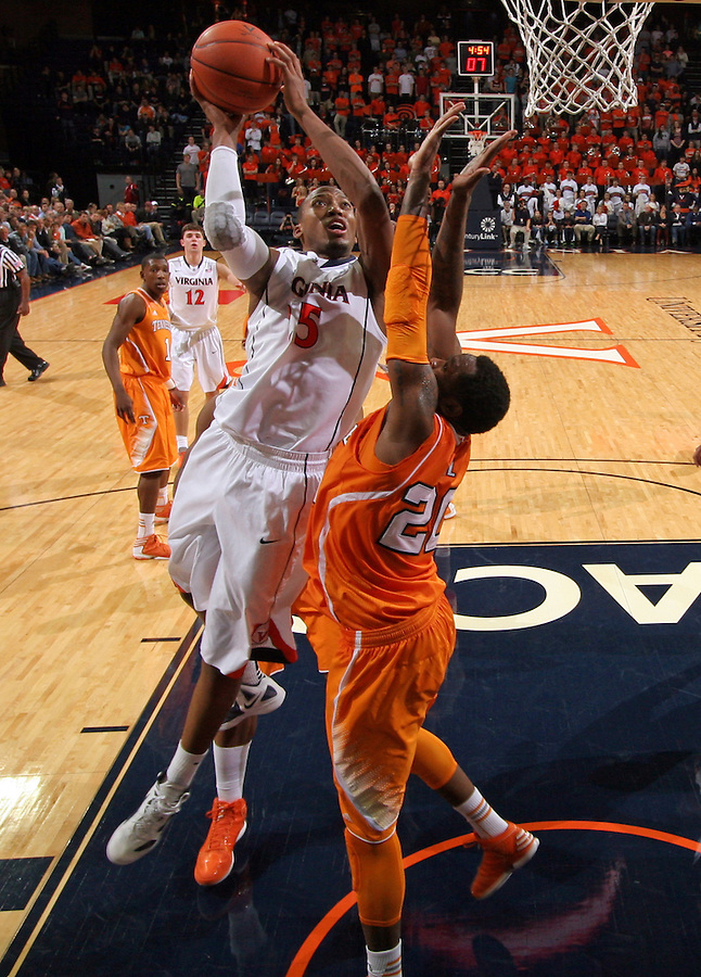 Virginia forward Akil Mitchell (25) shoots next to Tennessee forward Kenny Hall (20) during the game Wednesday in Charlottesville, VA. Virginia defeated Tennessee 46-38.