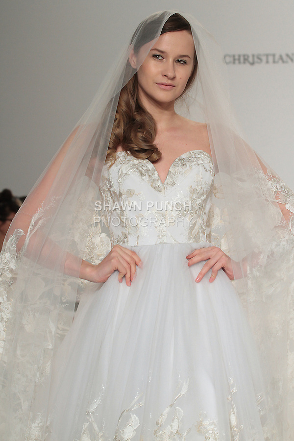 Model walks runway in a strapless lace gown, from the Christian Siriano for Kleinfeld bridal collection, at Kleinfeld on April 18, 2016 during New York Bridal Fashion Week Spring Summer 2017.