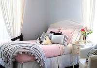 A girl's bedroom has a soft, pretty feel with pale pinks and lilacs.