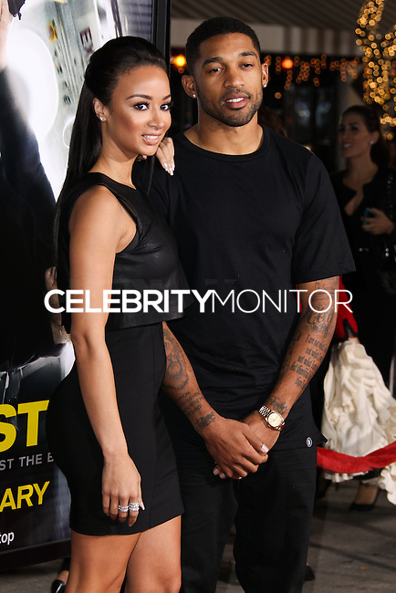 "WESTWOOD, CA, USA - FEBRUARY 24: Draya Michele, Orlando Scandrick at the World Premiere Of Universal Pictures And Studiocanal's ""Non-Stop"" held at Regency Village Theatre on February 24, 2014 in Westwood, Los Angeles, California, United States. (Photo by Xavier Collin/Celebrity Monitor)"