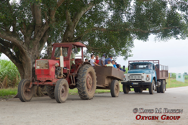 Tractor Pulling Cart Filled With Workers