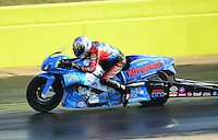Sept. 21, 2012; Ennis, TX, USA: NHRA pro stock motorcycle rider Chip Ellis during qualifying for the Fall Nationals at the Texas Motorplex. Mandatory Credit: Mark J. Rebilas-