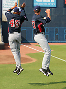 DJ Baxendale (48) and Brady Rodgers pump up in the air before Game 3 of the annual Collegiate Friendship Series between Team USA and Japan on Tuesday, July 5, 2011. Photo by Al Drago.