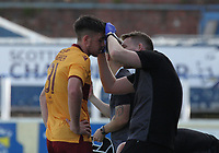 Declan Gallagher gets treatment to a head injury in the SPFL Betfred League Cup group match between Queen of the South and Motherwell at Palmerston Park, Dumfries on 13.7.19.