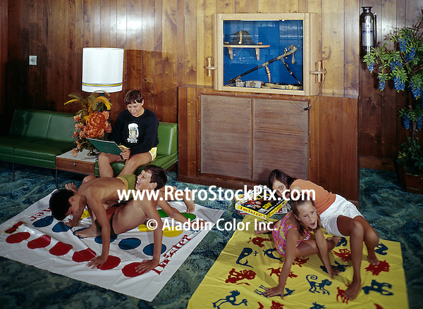 Group of children having fun together playing twister. 1960's.