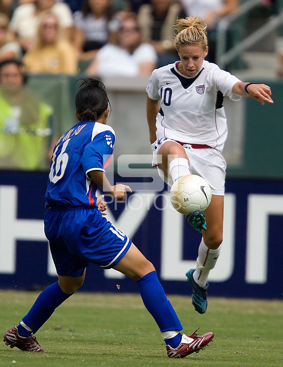 USA's Aly Wagner passes the ball during a 10-0 victory over Chinese Taipei, in Carson, California, Sunday, Oct. 1, 2006.
